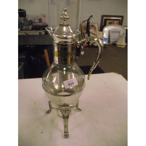 624 - Unusual silver plated glass decanter on stand....