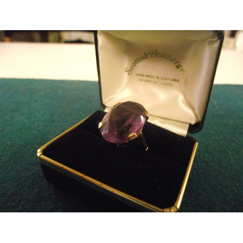 627 - 9ct Gold ring with large coloured stone  Approx 8g...