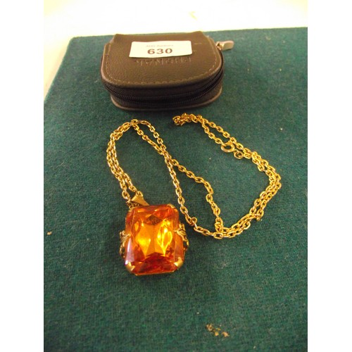 630 - Vintage necklace on yellow metal chain with large Orange stone....