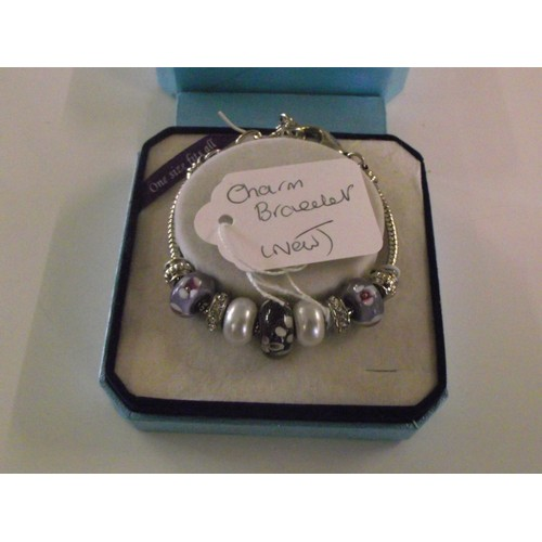 274 - New boxed charm bracelet