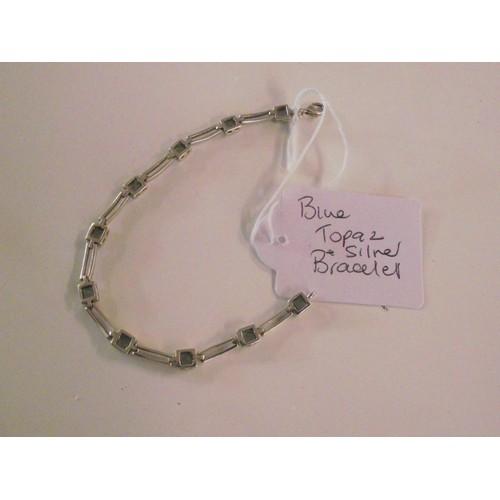 268 - Silver and blue topaz bracelet