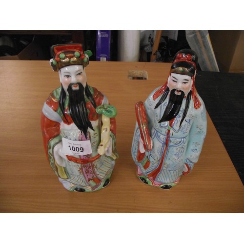 302 - 2 Chinese / Japanese ceramic figures. approx. 10 inches.