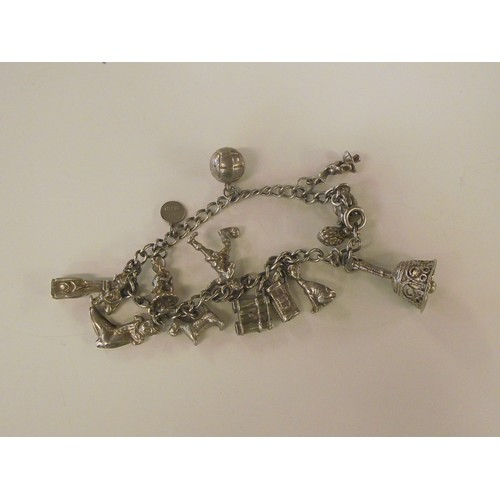 385 - Vintage White metal charm bracelet with some charms stamped silver