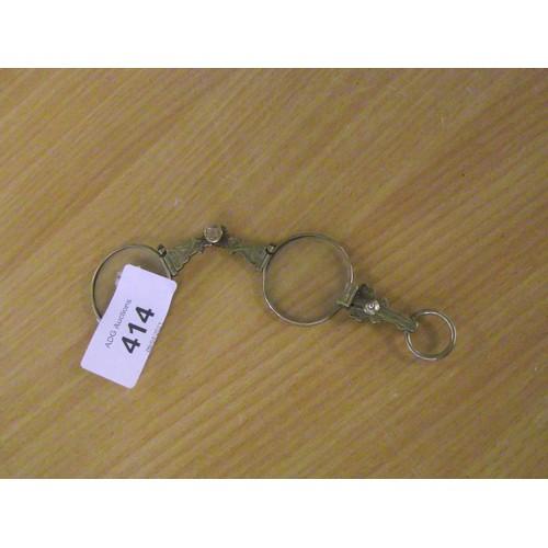 414 - Yellow metal pair of lorgnettes