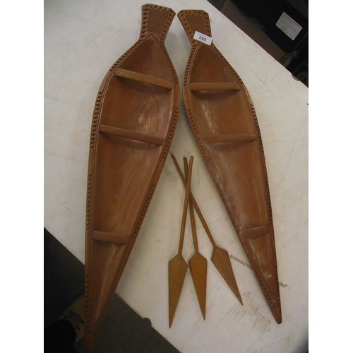 34 - 2 hand carved hardwood African? Shields with spears. approx. 25 inches x 6 inches....