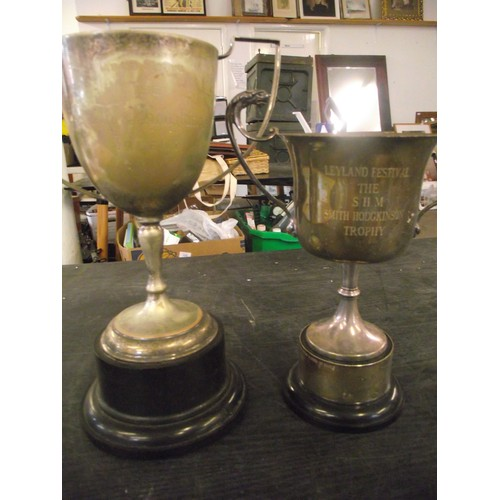 39 - 2 vintage silver plate trophies from Leyland Festival. Largest approx. 12 inches....