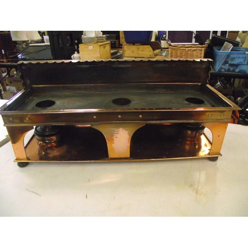 834 - Arts and crafts copper hotplates with 3 oil wicked burners with ebonised bun feet in great condition