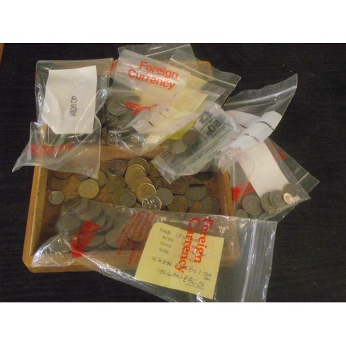 561 - Wooden box of assorted world coins