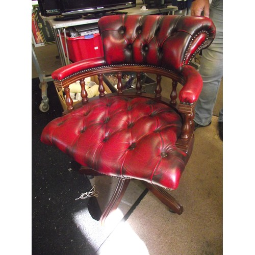 522 - Ox blood red Chesterfield captains swivel chair.