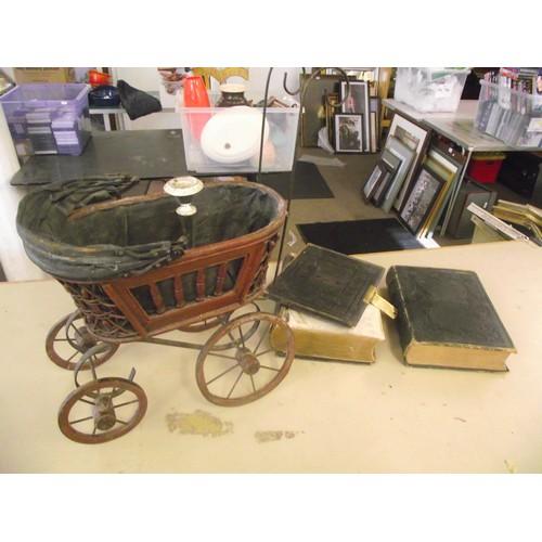148 - Victorian childs pram + 2 very old bibles etc.