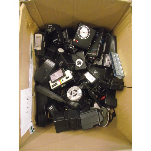 595 - Huge amount of camera flash guns, mounts, light meters etc.