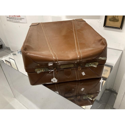 28 - Vintage Luggage: Oblong leather suitcase with shot silk lining. 23ins. x 19ins. x 12ins....