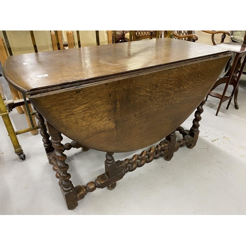 41 - 18th/19th cent. Oak gate leg dining table with barley twist supports. 46ins....