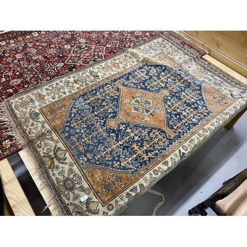42 - 20th cent. Blue ground Persian rug. 66ins. x 50ins....