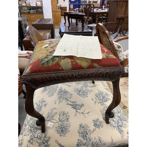 56 - 18th cent. French walnut footstool with cabriole supports and floral needlepoint upholstery....