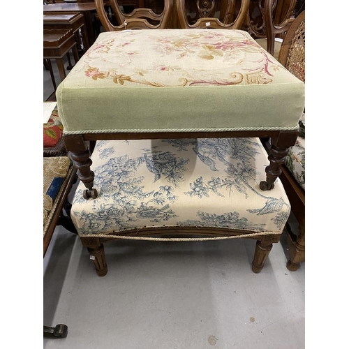 59 - 19th cent. Two large mahogany footstools with floral cushioned upholstery....