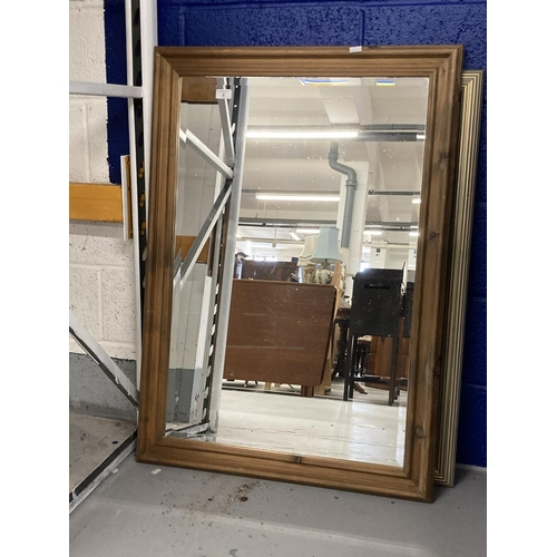 4 - 20th cent. Bevel edged decorative mirrors x 2. 29ins. x 41½ins. and 27ins. x 38ins.