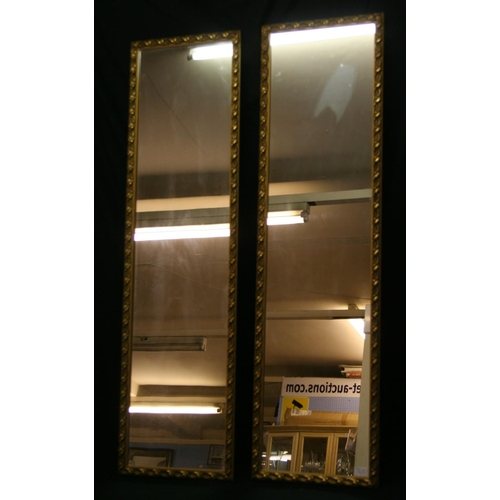 42 - Pair of gilt framed portrait wall mirrors...