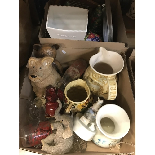 17 - Three boxes of assorted sundry items to include various decorative tins, vintage tennis rackets, var...