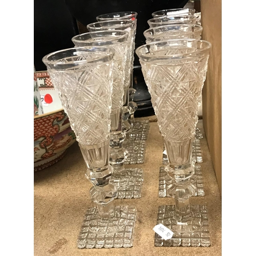 51 - A set of eight hobnail cut glass ale flutes on hobnail cut square bases, 21 cm high...