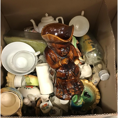 9 - Two boxes of assorted china and glass ware to include assorted crested wares, two treacle glazed Tob...