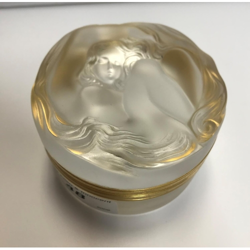 48 - A Lalique ''Daphne'' lidded box with the top decorated with maiden with flowing locks, 5 cm high...