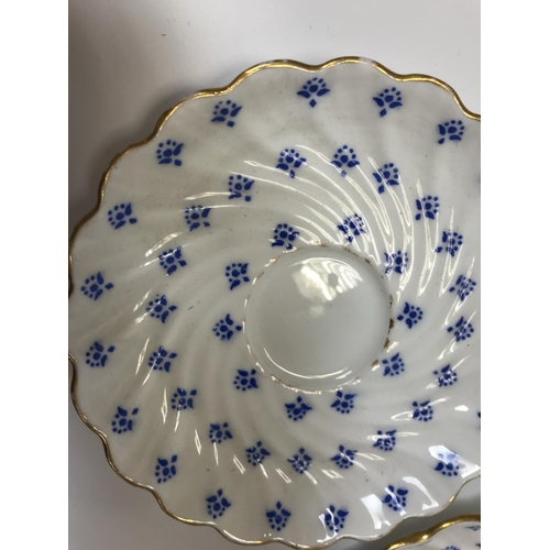 59 - A Coalport blue floral printed and gilt decorated coffee set of writhen form with gold serpentine ha...
