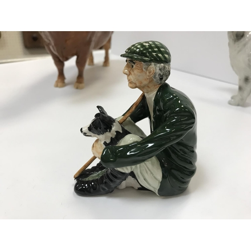 60 - An Isle of Man pottery figure of a bull inscribed to base ''Shebeg I.O.M. A. Thompson Thevassesck Ch...