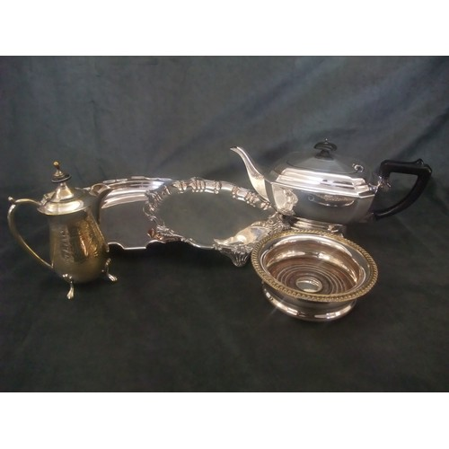 21 - A collection of EPNS including a teapot, bottle stand with gadroon border 14.5cm dia. cream jug, sal...