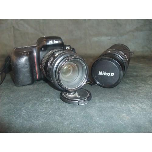 26 - A Nikon AF Zoom-Nikkor 35-135mm f/3.5-45 camera and an additional Nikon AF Nikkor 75-300mm lens....