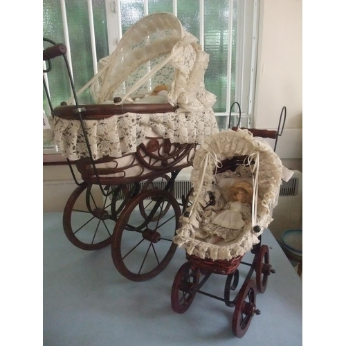 51 - A woven fibre and stained wood pram with a Somerset teddy bear and a smaller pram with a doll (2)....