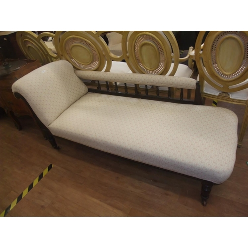 10 - Edwardian chaise longue, roll and side padded arm with spindle support on turned taper legs ending c...