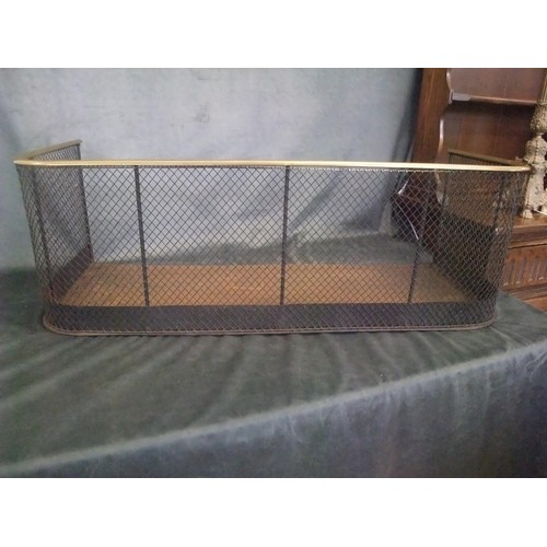 7 - A Victorian brass and mesh fireguard fender with raised sides, brass rail, 90cm wide....