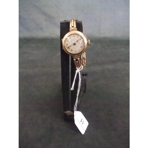 11 - Lady's 9ct gold wristwatch with a 9ct gold bracelet....