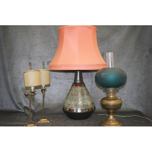 33 - A pair of lacquered brass table lamps, with shades, each 47cm high, a brass oil lamp, with coloured ...