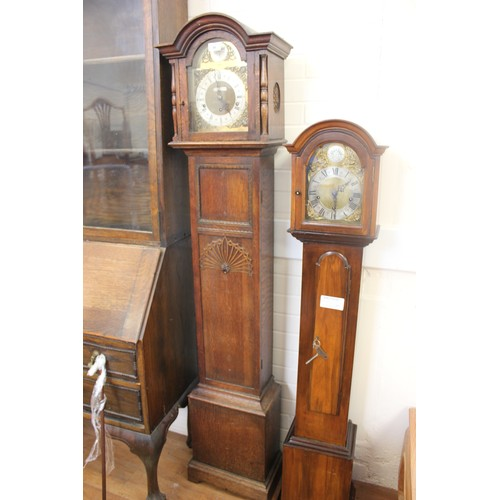 42 - A 20th century oak grandmother clock, with arched dial, retailed by