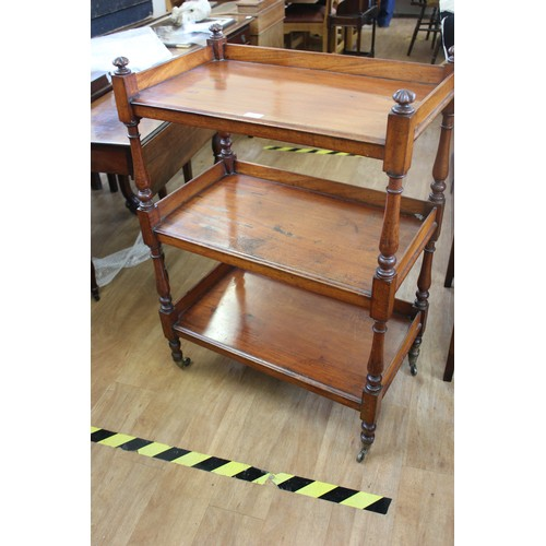 43 - A Victorian mahogany three tier buffet with turned supports, on squat turned legs, with casters, 69c...