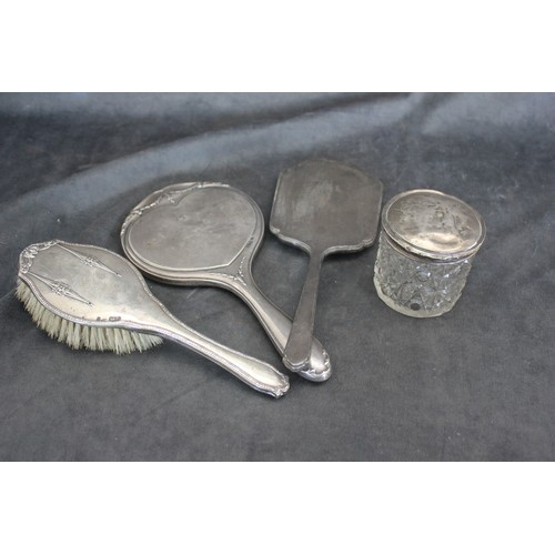 59 - A silver backed part dressing table set, mixed dates and pattern, together with a toilet jar, and si...
