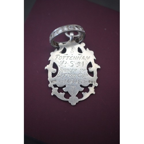31 - A silver medal inscribed Tottenham P S Runner Up Lytton Cup 1908 and an eternity ring, single row of...