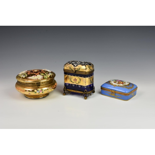 18 - A French porcelain and gilt metal box, 20th century, painted with a floral reserve with gilt borders...