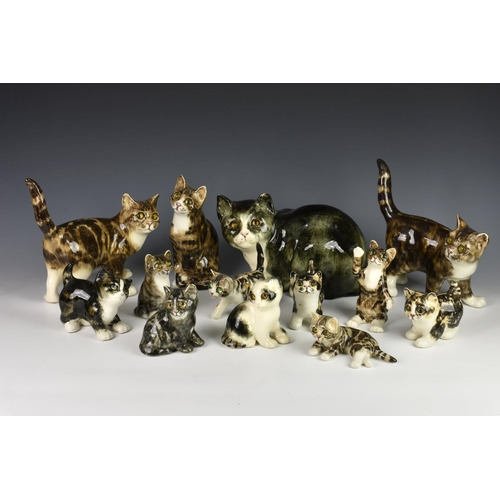 26 - A collection of Winstanley cat figurines, in different breeds, sizes and poses, each having glass ey...