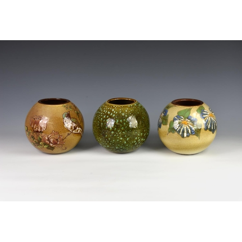 28 - Three Guernsey pottery vases, each of globular form, one decorated with bird and flowers on mustard ...