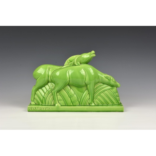 4 - Charles Lemanceau - A French Art Deco green glazed pottery figure group of two stylized buffalo or d...
