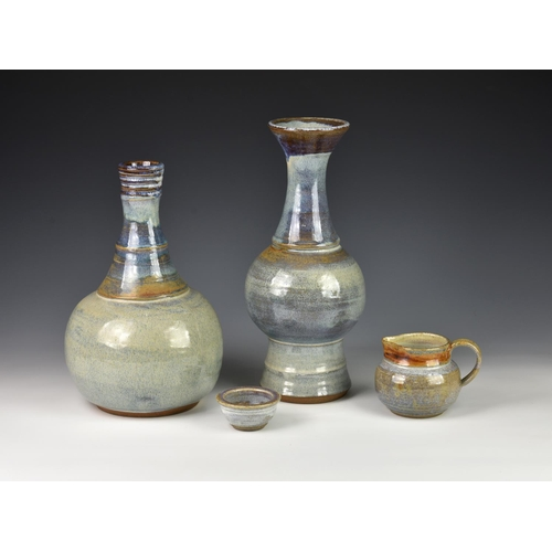 49 - Two Guernsey Pottery vases, the first of bottle form with elongated neck, decorated in shades of blu...