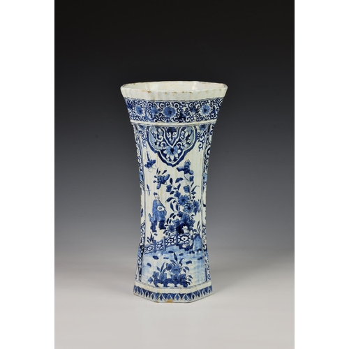55 - A Dutch Delft trumpet form vase, probably 19th century, of fluted, octagonal form, painted in blue w...