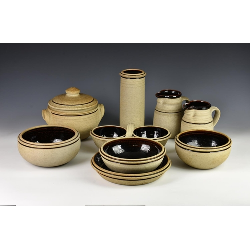 59 - A collection of Studio Pottery stoneware, possibly Channel Islands, unglazed with brown slip decorat...
