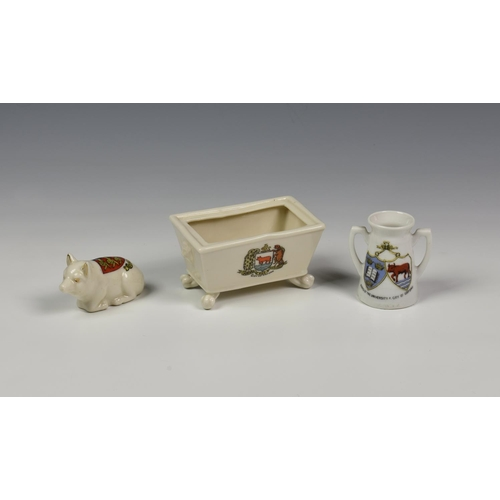 52 - A small collection of Commemorative crested ware related to WWI, comprising three pieces by Arcadian...