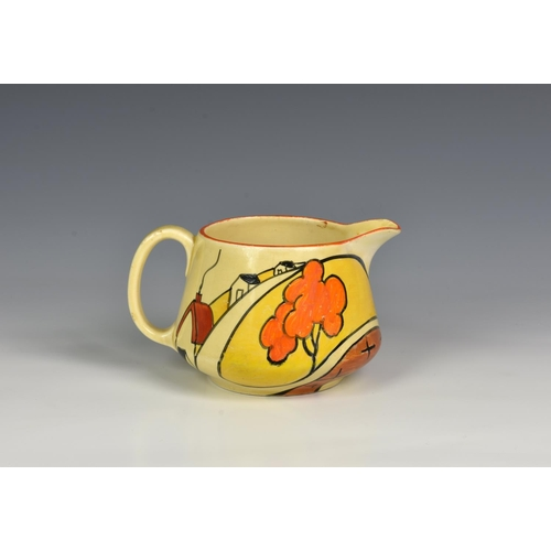 6 - A Clarice Cliff Fantasque / Bizarre Art Deco period hand painted milk jug (42) in the 'House and Bri...
