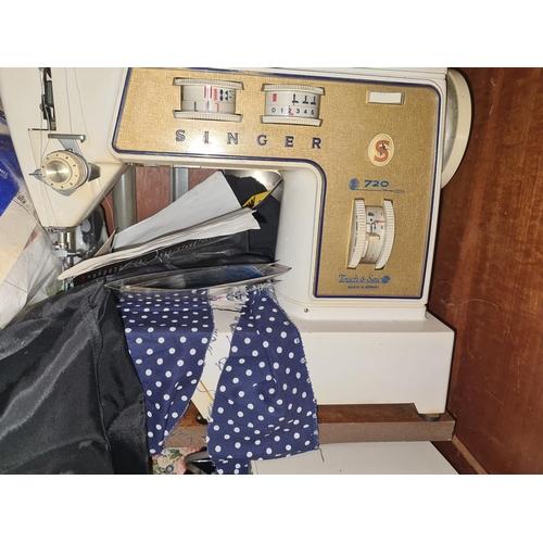 21 - Sewing Machine in Mid Century Teak Cabinet...