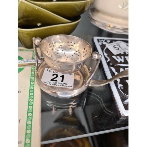 21 - White Metal Tea Strainer...